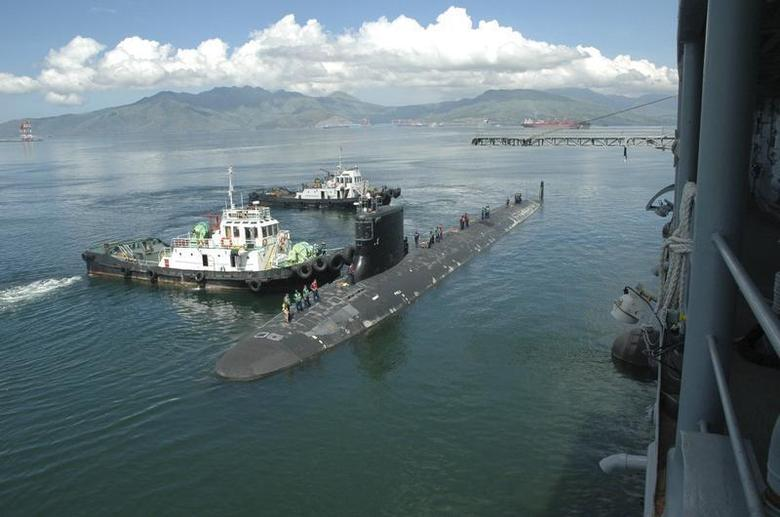 The Virginia-class submarine USS Hawaii pulls alongside the submarine tender USS Frank Cable in Subic Bay, in this September 6, 2012 handout photo courtesy of the U.S. Navy. REUTERS/U.S. Navy/Chief Mass Communication Specialist Jennifer L. Walker/Handout