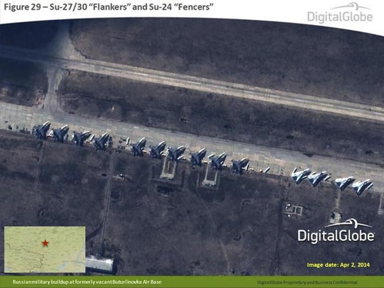 A satellite image provided to Reuters by Supreme Headquarters Allied Powers Europe (SHAPE) on April 10, 2014 and taken by DigitalGlobe on April 2, 2014 shows what is reported by SHAPE to be Russian Su-27/30 Flankers and Su-24 Fencers at a military base in Buturlinovka, southern Russia. REUTERS/DigitalGlobe via SHAPE/Handout via Reuters