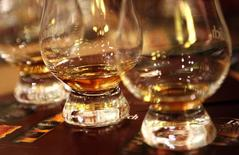 Glasses of scotch whisky sit on a table during a tour of the Glenfiddich scotch whisky distillery in Dufftown, Scotland January 13, 2013. REUTERS/David Moir