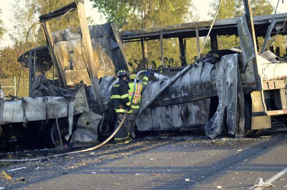 Fire-fighters douse the wreckage at the scene of a collision of a tractor-trailer and a tour bus on Interstate 5 near Highway 32 near Orland, California, April 10, 2014, in this handout courtesy of the Chico Enterprise Record. REUTERS-Dan Reidel-Chico Enterprise Record-Handout via Reuters