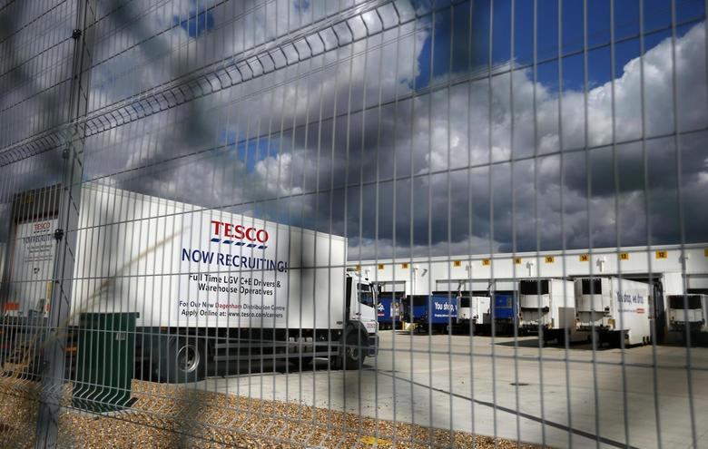 A lorry with job advertisements on its side is seen parked at Tesco's new distribution centre in Dagenham, east London August 12, 2013. REUTERS/Andrew Winning