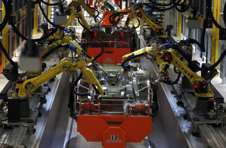 Robotic Arms work on the underside of the 2015 Chrysler 200 vehicle at the Sterling Heights Assembly Plant in Sterling Heights, Michigan March 14, 2014. REUTERS/Rebecca Cook