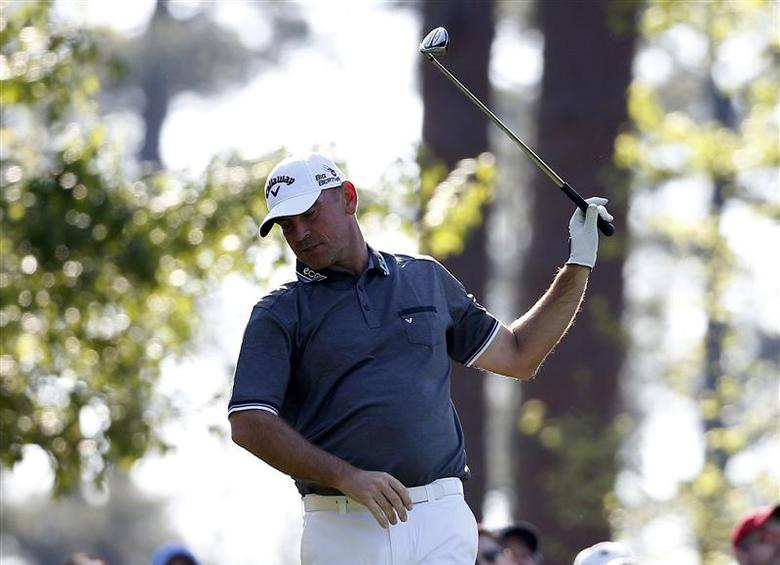 Denmark's Thomas Bjorn reacts after his tee shot on the fourth hole during the second round of the Masters golf tournament at the Augusta National Golf Club in Augusta, Georgia April 11, 2014. REUTERS/Jim Young