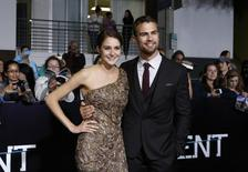 "Cast members Shailene Woodley and Theo James pose at the premiere of ""Divergent"" in Los Angeles, California in this file photo taken March 18, 2014. REUTERS/Mario Anzuoni/Files"