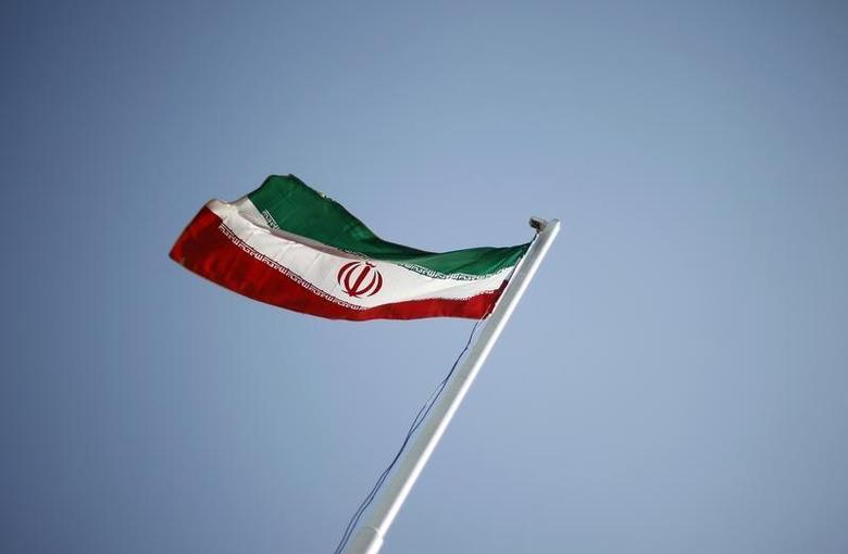 An Iranian national flag flutters during the opening ceremony of the 16th International Oil, Gas & Petrochemical Exhibition (IOGPE) in Tehran April 15, 2011. REUTERS/Morteza Nikoubazl