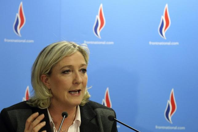 Marine Le Pen, France's far-right National Front political party leader, gestures as she delivers a speech after the second round in the French mayoral elections at the party headquarters in Nanterre, March 30, 2014. REUTERS/Pascal Rossignol