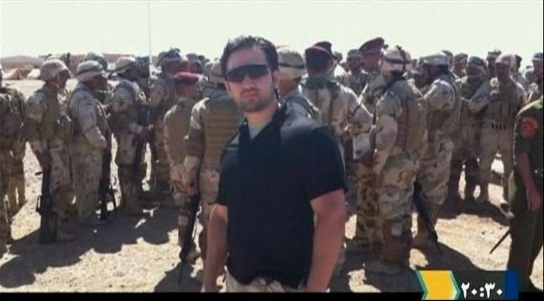 Iranian-American Amir Mirza Hekmati, who has been sentenced to death by Iran's Revolutionary Court on the charge of spying for the CIA, stands with Iraqi soldiers in this undated still image taken from video in an undisclosed location made available to Reuters TV on January 9, 2012. REUTERS