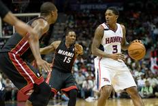 Apr 12, 2014; Atlanta, GA, USA; Miami Heat guard Mario Chalmers (15) defends Atlanta Hawks guard Louis Williams (3) during the fourth quarter at Philips Arena. The Hawks won 98-85. Mandatory Credit: Kevin Liles-USA TODAY Sports