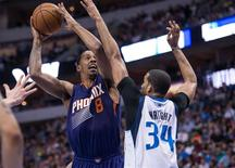 Apr 12, 2014; Dallas, TX, USA; Dallas Mavericks forward Brandan Wright (34) defends against Phoenix Suns forward Channing Frye (8) during the first half at the American Airlines Center. Mandatory Credit: Jerome Miron-USA TODAY Sports