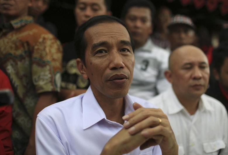 Jakarta governor and presidential candidate Joko Widodo looks on during PDIP party campaign in Jakarta March 16, 2014. REUTERS/Beawiharta