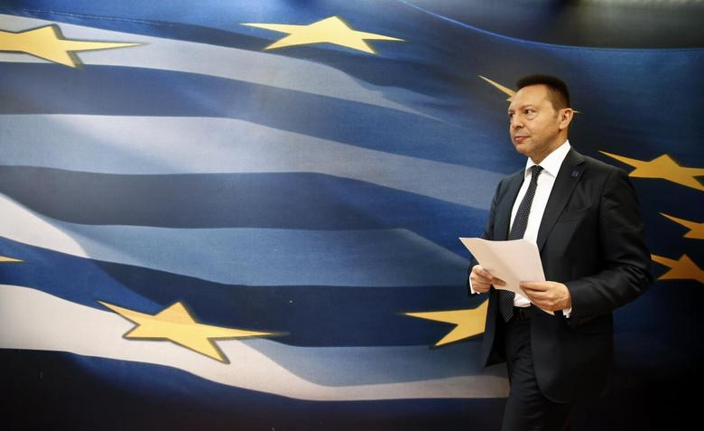 Greece's Finance Minister Yannis Stournaras arrives for a news briefing following his meeting with European Competition Commissioner Joaquin Almunia at a ministry hall in Athens April 10, 2014. REUTERS/Yorgos Karahalis
