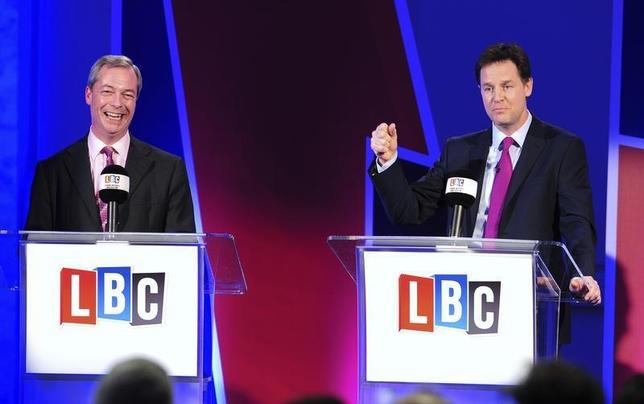 UK Independence Party leader Nigel Farage (L), and Nick Clegg, leader of Britain's Liberal Democrat party, speak during a debate on Britain's future in the European Union, in London March 26, 2014. REUTERS/Ian West/pool