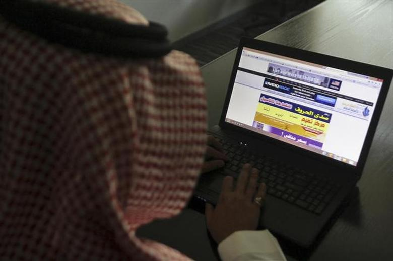 A Saudi man explores a website on his laptop in Riyadh in this file photo taken on February 11, 2014. REUTERS/Faisal Al Nasser/Files