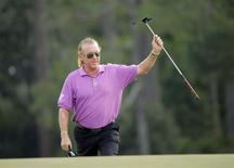 Spain's Miguel Angel Jimenez walks to the 18th green during the final round of the Masters golf tournament at the Augusta National Golf Club in Augusta, Georgia April 13, 2014. REUTERS/Brian Snyder