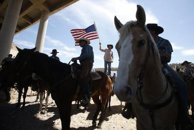 Rancher's son says force was necessary to stop cattle...