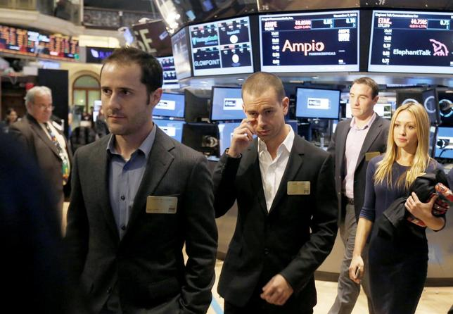 Twitter co-founders Evan Williams (L) and Jack Dorsey (C) walk together during the Twitter Inc. IPO on the floor of the New York Stock Exchange in New York, November 7, 2013. REUTERS/Lucas Jackson