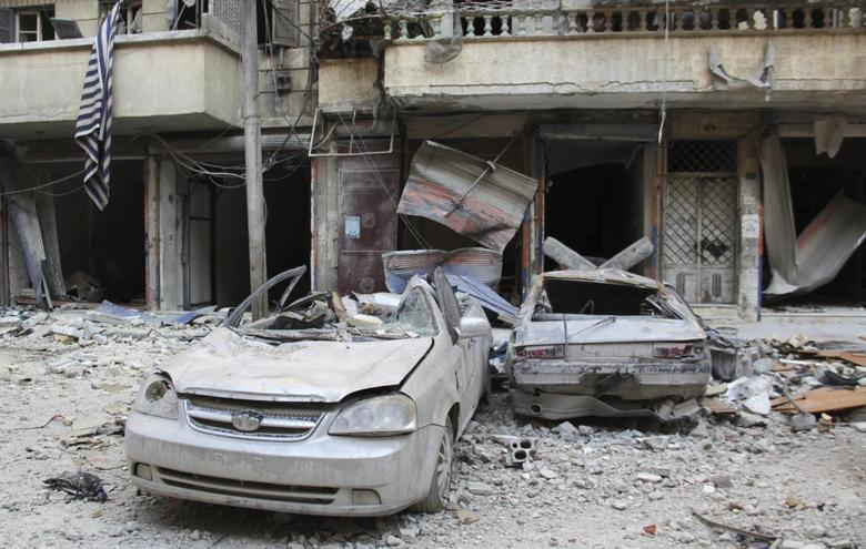 A view of damaged cars along a damaged street in Aleppo's district of al-Sukari April 4, 2014. REUTERS/Aref Haj Youssef