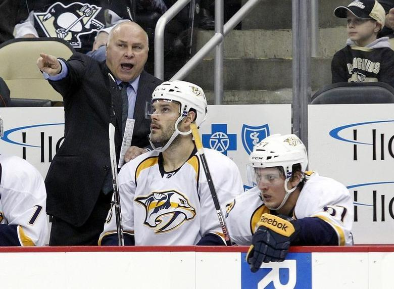 Nov 15, 2013; Pittsburgh, PA, USA; Nashville Predators head coach Barry Trotz (left) reacts on the bench against the Pittsburgh Penguins during the third period at the CONSOL Energy Center. Charles LeClaire-USA TODAY Sports