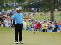 U.S. golfer Fred Couples reacts after missing a putt on the seventh hole during the final round of the Masters golf tournament at the Augusta National Golf Club in Augusta, Georgia April 13, 2014. REUTERS/Brian Snyder