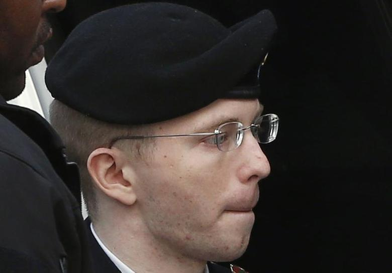 U.S. soldier Bradley Manning is escorted into court to receive his sentence at Fort Meade in Maryland August 21, 2013. REUTERS/Kevin Lamarque