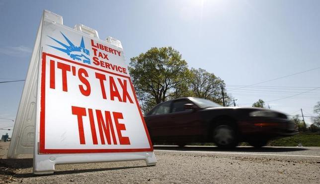 A car passes a sign advertising tax return services in Falls Church, Virginia April 8, 2010. REUTERS/Kevin Lamarque