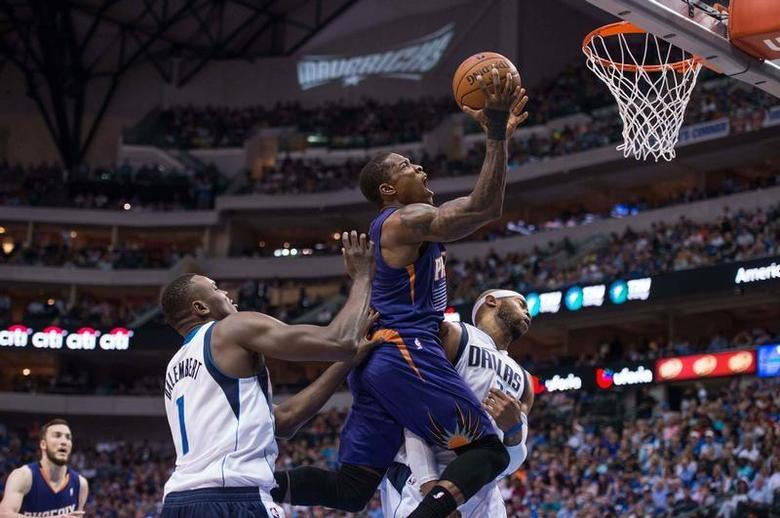 Phoenix Suns guard Eric Bledsoe (2) drives to the basket past Dallas Mavericks center Samuel Dalembert (1) and guard Vince Carter (25) during the first half at the American Airlines Center. Jerome Miron-USA TODAY Sports