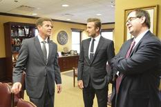 Florida's Senate President-designate Andy Gardiner, Republican of Orlando, talks with former England soccer player David Beckham (C) and Mark Abbott, president and deputy commissioner of Major League Soccer during a visit to the state legislature in Tallahassee, Florida March 25, 2014. REUTERS/Bill Cotterell
