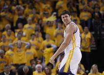 Golden State Warriors Andrew Bogut reacts during their loss to the San Antonio Spurs in their NBA Western Conference semi-final playoff basketball game in Oakland, California May 10, 2013. REUTERS/Robert Galbraith