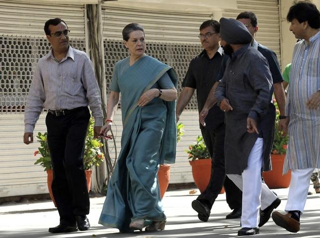 Sonia Gandhi (2nd L), chief of India's ruling Congress party, arrives to cast her vote at a polling station in New Delhi April 10, 2014. REUTERS/Vijay Mathur