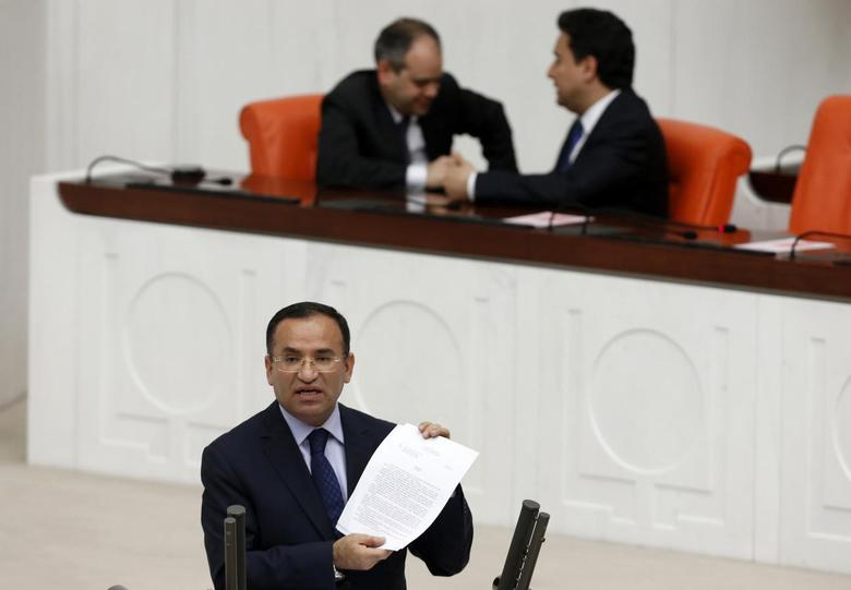 Justice Minister Bekir Bozdag addresses the Turkish Parliament during a debate in Ankara March 19, 2014. REUTERS/Umit Bektas