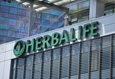 The Herbalife logo is seen on a building housing some of their offices in downtown Los Angeles, California April 28, 2013. REUTERS/Lucy Nicholson