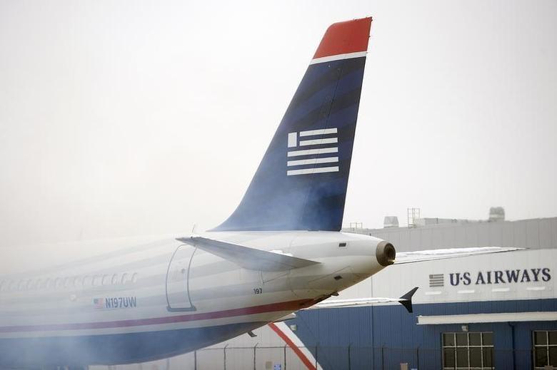 A US Airways Airbus A321-200 plane emits exhaust at Philadelphia International Airport in Philadelphia, Pennsylvania on December 9, 2013. REUTERS/Mark Makela