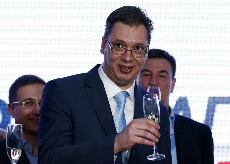 Serbian Deputy Prime Minister and the leader of Serbian Progressive Party (SNS) Aleksandar Vucic toasts with champagne at the party headquarters in Belgrade March 16, 2014. REUTERS/Marko Djurica