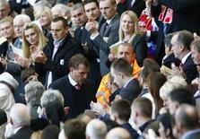 Liverpool manager Brendan Rodgers is applauded after speaking during a memorial service to mark the 25th anniversary of the Hillsborough disaster at Anfield in Liverpool, northern England April 15, 2014. REUTERS/Darren Staples
