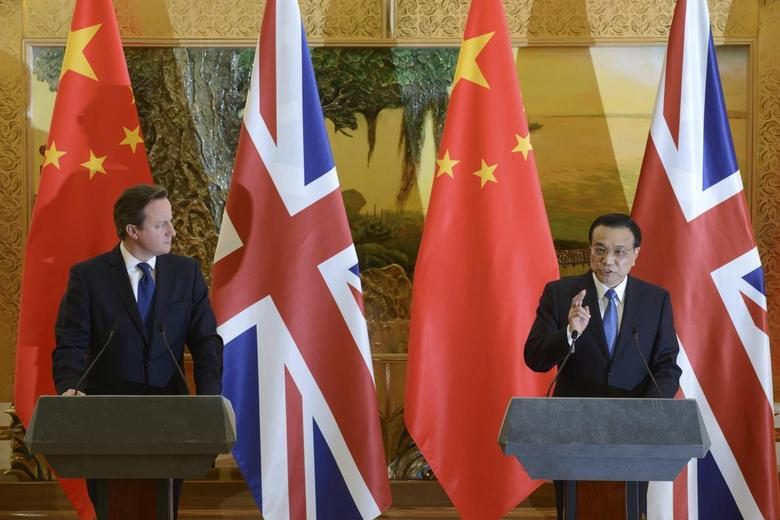 Britain's Prime Minister David Cameron (L) listens to China's Premier Li Keqiang as the two leaders deliver statements following a signing ceremony at the Great Hall of the People in Beijing December 2, 2013. REUTERS/Ed Jones/Pool