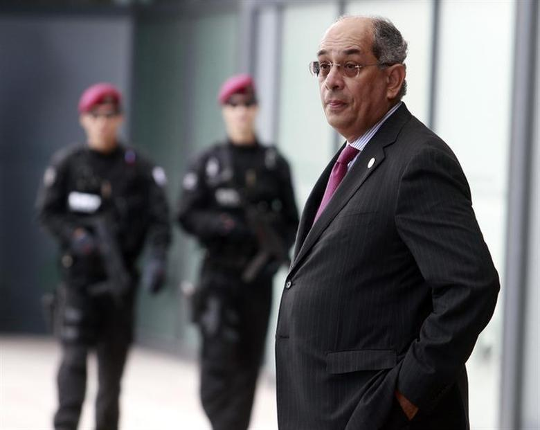 Youssef Boutros-Ghali, Chairman of the International Monetary and Financial Committee (IMFC), stands in front of security officers at the venue of the G20 Finance Ministers and Central Bank Governors meeting in Gyeongju, southeast of Seoul, in this October 22, 2010 file photo. REUTERS/Nicky Loh