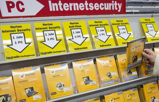 A man takes a box of internet security software from a shelf at an electronic retailer in Berlin, July 11, 2013. REUTERS/Thomas Peter