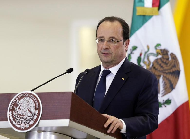 French President Francois Hollande addresses the audience at the National Aeronautic University of Queretaro in Queretaro April 11, 2014. REUTERS/Henry Romero
