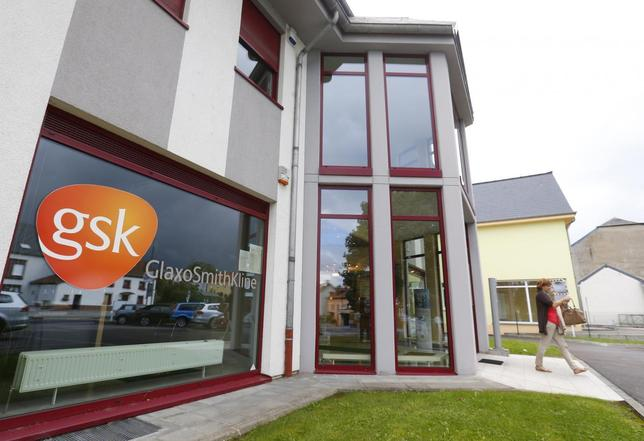 The GlaxoSmithKline logo is seen at the entrance of a building in Luxembourg, September 10, 2013. Picture taken September 10, 2013 REUTERS/Yves Herman