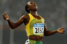 Veronica Campbell-Brown of Jamaica celebrates winning the women's 200m final of the athletics competition in the National Stadium at the Beijing 2008 Olympic Games August 21, 2008. REUTERS/Gary Hershorn