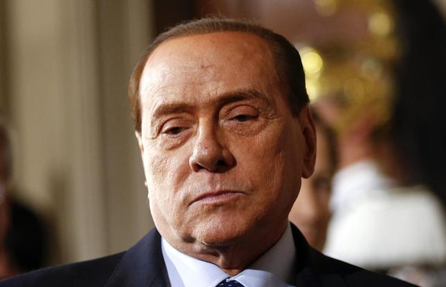 Leader of Forza Italia party Silvio Berlusconi arrives to talk to reporters at the end of the consultations with Italian President Giorgio Napolitano at the Quirinale Palace in Rome February 15, 2014. REUTERS/Tony Gentile