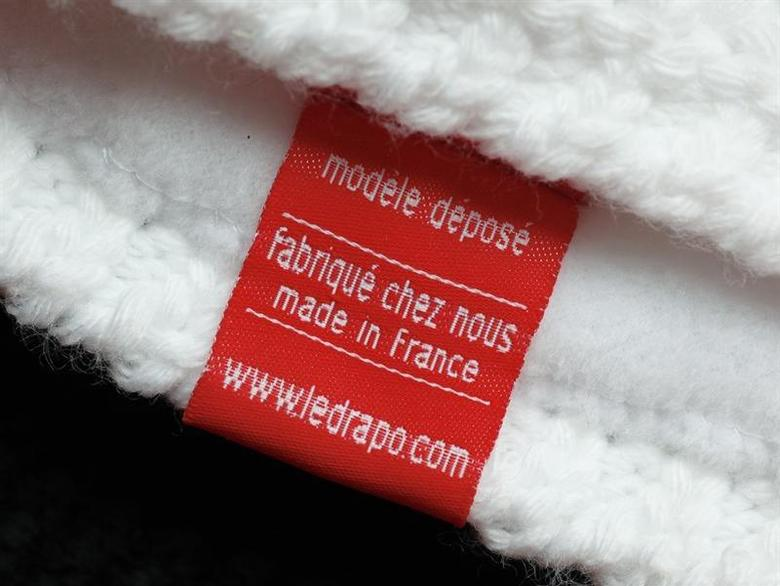 The label ''Made at Home, Made in France'' is seen on a winter hat in this illustration picture taken in Lyon February 25, 2013. REUTERS/Robert Pratta