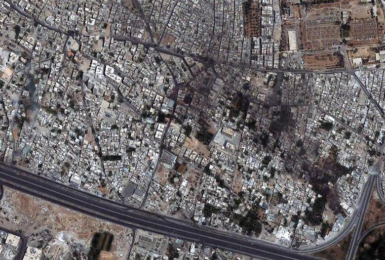 DigitalGlobe Satellite image shows a tank on 6th Rishreen road in the lower left portion of the image in Qabun neighborhood in Damascus, Syria, July 18, 2012. REUTERS/ DigitalGlobe/Handout
