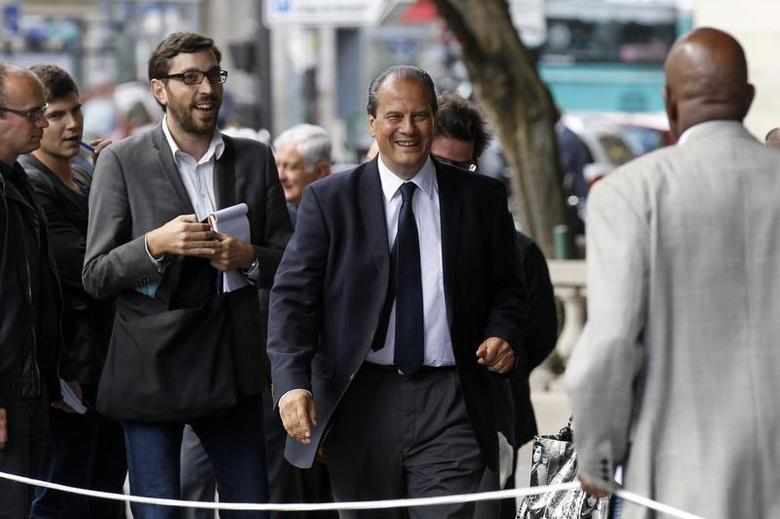 France's Socialist party member Jean-Christophe Cambadelis (C) arrives to attend the national council of French Socialist party in Paris September 12, 2012. REUTERS/Benoit Tessier
