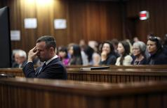Olympic and Paralympic track star Oscar Pistorius reacts during his trial at North Gauteng High Court in Pretoria April 15, 2014. REUTERS/Siphiwe Sibeko