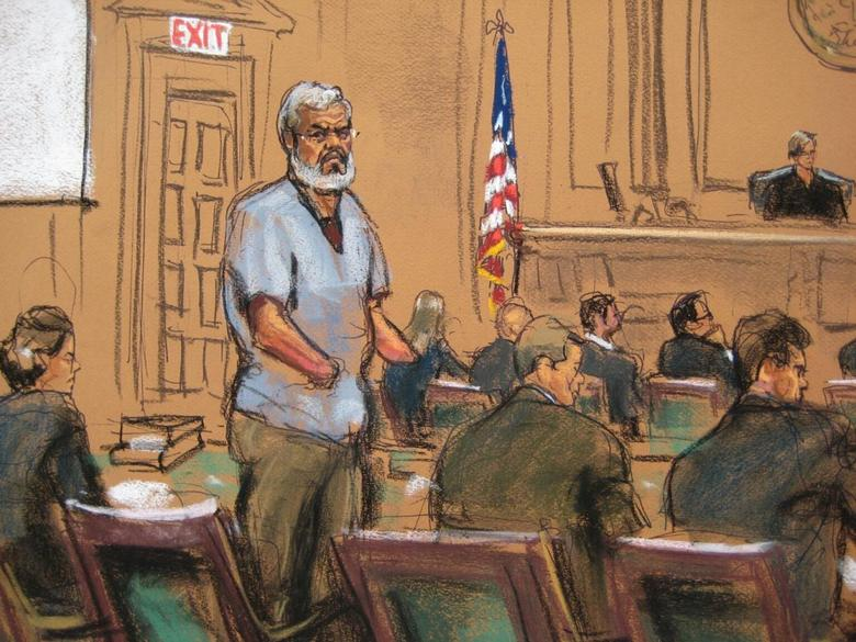 Abu Hamza al-Masri, the radical Islamist cleric facing U.S. terrorism charges, stands with his legal team in Manhattan federal court in New York in this artist's sketch, April 14, 2014. REUTERS/Jane Rosenberg