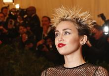 "Singer and actress Miley Cyrus arrives at the Metropolitan Museum of Art Costume Institute Benefit celebrating the opening of ""PUNK: Chaos to Couture"" in New York, May 6, 2013. REUTERS/Lucas Jackson"