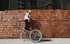 A labourer works at a construction site in Hangzhou, Zhejiang province, April 14, 2014. REUTERS/William Hong