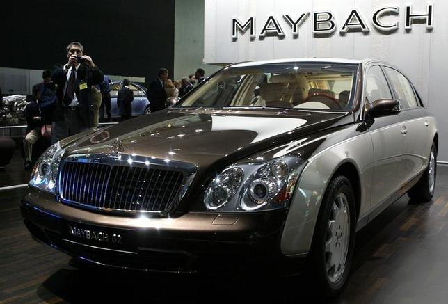 A visitor takes pictures of Mercedes Benz Maybach 62 long version during the so-called media day at the International car show IAA September 9, 2003. REUTERS/Kai Pfaffenbach REUTERS