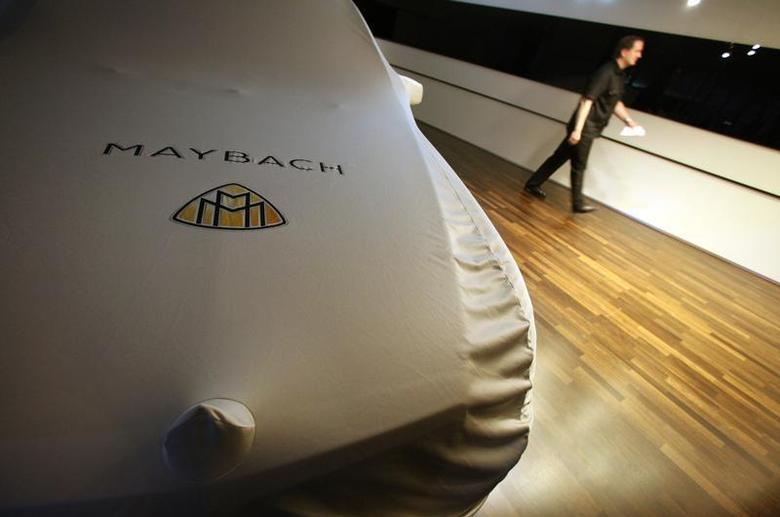 A covered Maybach luxury car stands at the booth of German car manufacturer Mercedes-Benz during preparation work for the International Motor Show (IAA) in Frankfurt, September 12, 2011. REUTERS/Ralph Orlowski